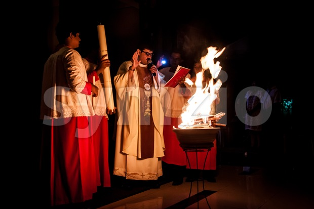 KUALA LUMPUR, April 19, 2014: Catholics celebrated Easter eve mid-night mass at Church of St. Thomas More in Malaysia. The priest lighted up the new Stock Photo