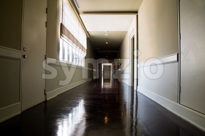 Dark and empty corridor with available natural light from window Stock Photo