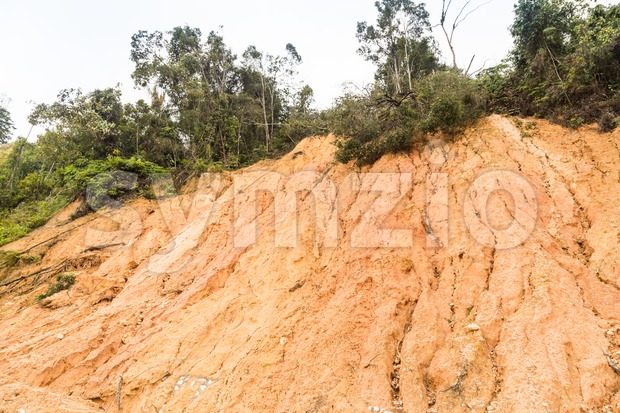 Slope erosion with earth collapse at slope in tropical environment Stock Photo