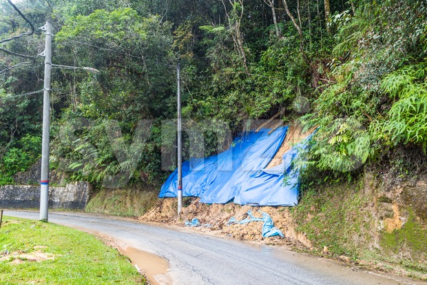 Huge plastic sheets used to temporarily halt slope soil erosion Stock Photo