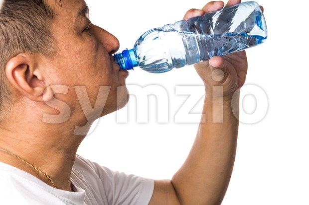 Closeup of man drinking refreshing cold water from bottle with white background