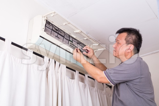 Series of technician servicing the indoor air-conditioning unit. Removing filter. Stock Photo