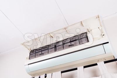 Dirty air conditioning unit full of dust dirt on filters Stock Photo