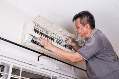 Series of technician servicing the indoor air-conditioning unit. Cleaning. Stock Photo