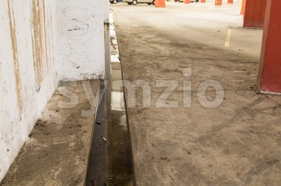 Indoor clogged drainage stagnant water potential breeding ground for mosquito Stock Photo