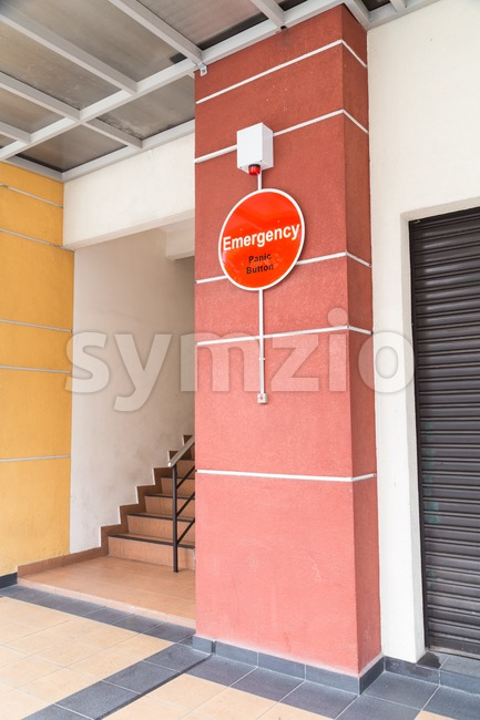 Emergency panic button at building for security alert Stock Photo