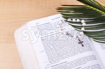 Closeup Catholic rosary with crucifix and beads on Holy Bible Stock Photo