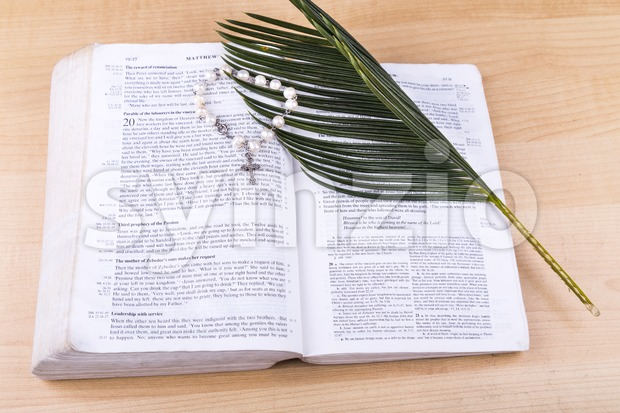 Closeup Catholic rosary with crucifix and beads on bible Stock Photo