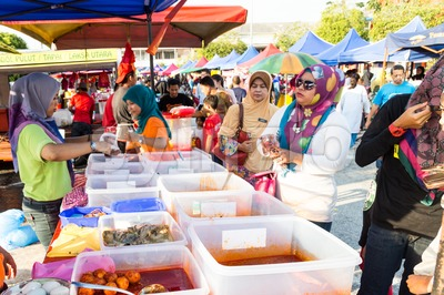 Vendors selling cuisine at street bazaar catered for iftar or breaking fast during the Muslim fasting month of Ramadan. Fasting for the year 2016 is Stock Photo