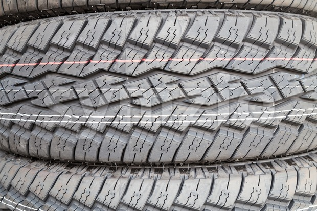 Closeup of new tire threads with deep groves for grip and traction