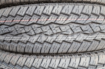 Closeup of new tire threads with deep groves for traction Stock Photo