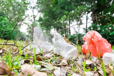 Environmental unfriendly non biodegradable pvc litter in public park Stock Photo