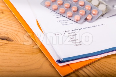 Medical report focusing on Uric Acid section, with medicine strips Stock Photo