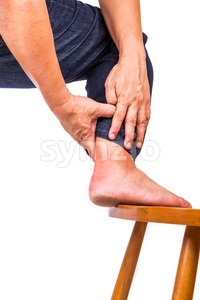Man with painful inflammation at back of foot Stock Photo