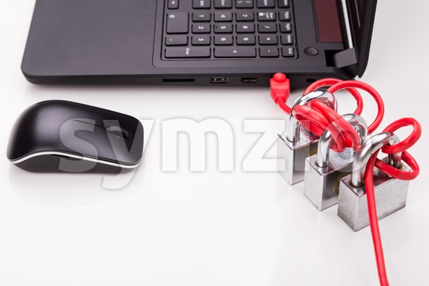 Concept of computer network security with triple padlocks over cable Stock Photo