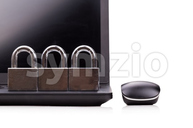Concept of computer security with padlock as shield over laptop in white background