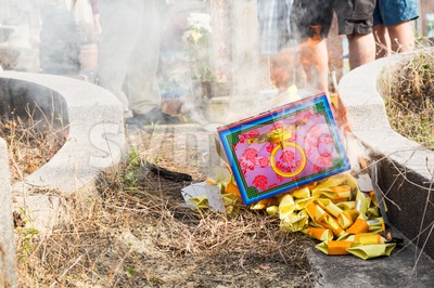 KUALA LUMPUR, MALAYSIA, April 2, 2016: Chinese descendants burnt offerings to ancestors during the annual QingMing festival, or tomb sweeping day at Stock Photo