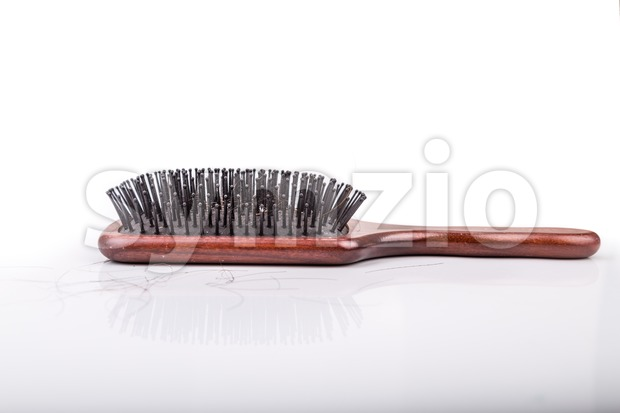Comb with strand of hair on white background Stock Photo