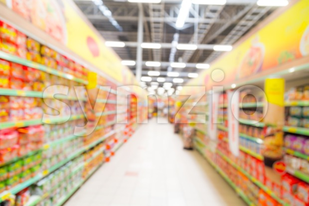 Defocused brightly lit colourful grocery aisle in a modern hypermarket Stock Photo