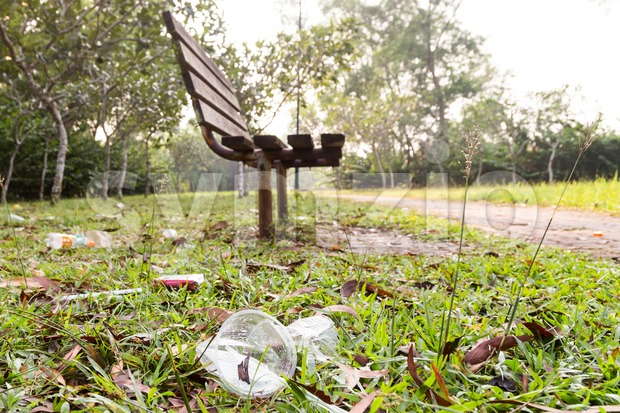 Lots of litter of non degradable rubbish at public park. Stock Photo