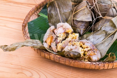 Freshly steamed Chinese rice dumpling on traditional rattan tray Stock Photo