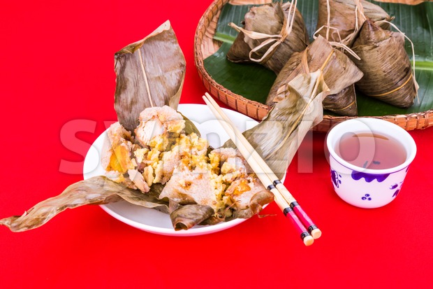 Steamed Chinese rice dumpling or zongzi served with oriental tea Stock Photo