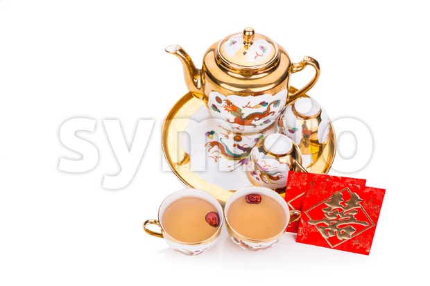 Generic traditional Chinese tea set with generic red envelope bearing the word double happiness, in white background