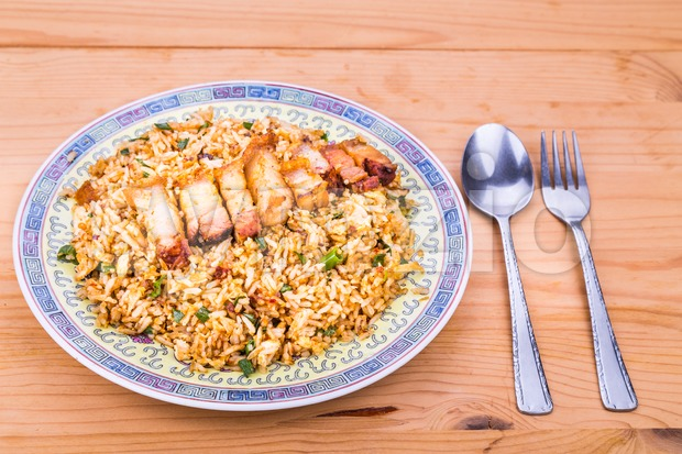 Delicious Chinese spicy fried rice with roast pork on plate Stock Photo