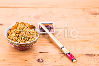 Delicious Chinese spicy fried rice with roast pork in bowl Stock Photo