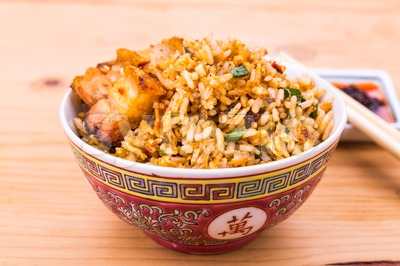 Closeup Chinese spicy fried rice with roast pork in bowl Stock Photo