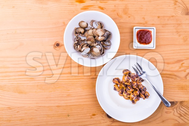 Boiled and prepared cockles with chili dip delicacy among Asians Stock Photo