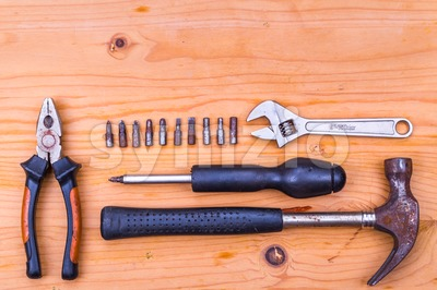 Essential basic tools set consisting hammer, plier, screwdriver, adjustable crescent Stock Photo