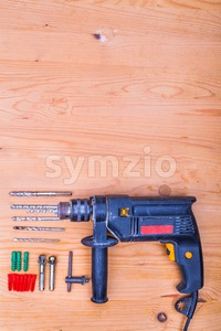 Flatbed of impact drilling set with bits and wall plugs Stock Photo