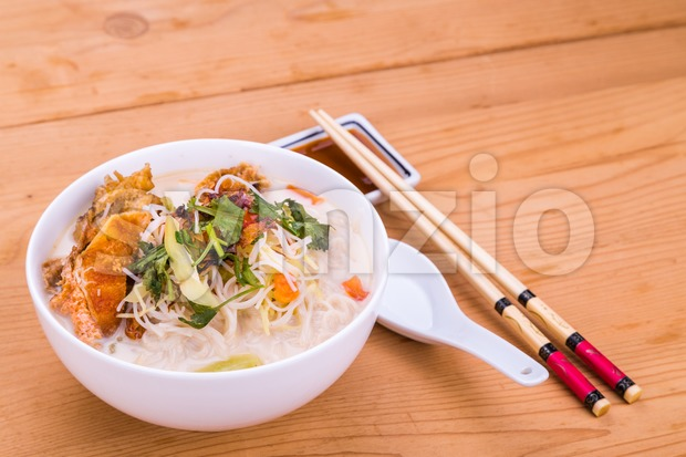 Rice vermicelli fried fish head noodle soup, delicacy  in Malaysia Stock Photo