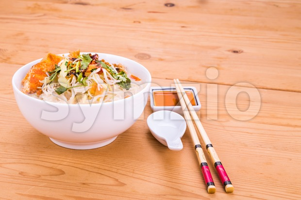 Rice vermicelli with fried fish head noodle soup, a popular delicacy in Malaysia