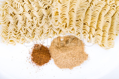 Closeup on unhealthy flavoring powder with uncooked instant noodles Stock Photo