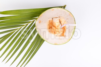 Refreshing green organic coconut fruit juice on white background Stock Photo