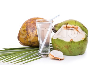 Refreshing green coconut fruit juice in glass on white background Stock Photo