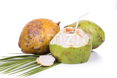 Three refreshing green organic coconut fruit juice on white background Stock Photo