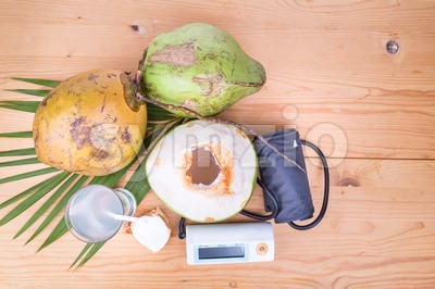 Fresh coconut juice helps to lower blood pressure and hypertension Stock Photo