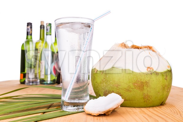 Refreshing coconut fruit juice re-hydrates and helps relief alcohol hangover Stock Photo