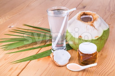 Refreshing green coconut juice with natural pure honey drinks Stock Photo