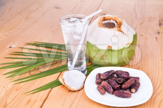 Coconut juice and sweet dates are simple and common iftar break fast food for muslim during fasting month of Ramadan