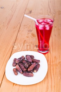 Sweet syrup, dates, simple iftar break fast food during Ramadan Stock Photo