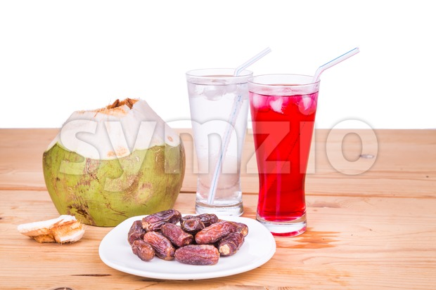 Coconut juice, syrup, dates simple iftar break fast during Ramadan Stock Photo