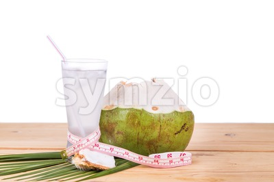 Natural coconut juice helps in body weight loss Stock Photo