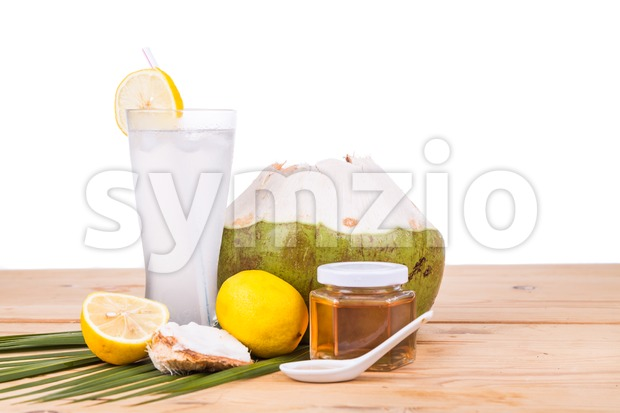 Refreshing natural green coconut with honey and lemon drinks Stock Photo