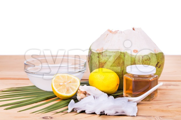 Natural face mask of coconut, lemon, honey to moisturize skin Stock Photo
