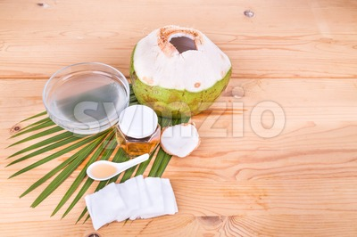 Coconut juice with honey are natural toner to reduce face acne Stock Photo