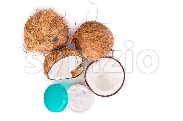 Tub containing coconut oil are used as moisturizer for skin Stock Photo